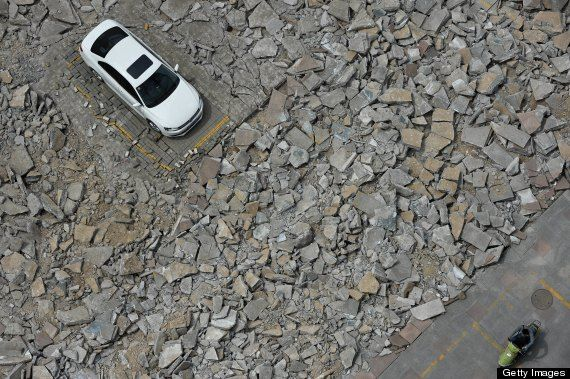 Chinese car left on destroyed road