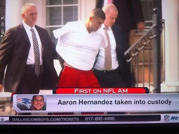 Aaron Hernandez led from home in handcuffs