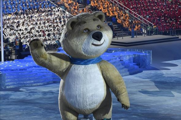 Sochi bear blows out torch